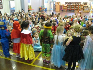 A parade of book characters in the school hall.