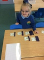 Lily is proud of how many numbers she can partition into tens and ones.